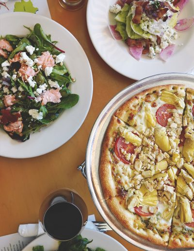 Chicken pesto pizza with salads on the side
