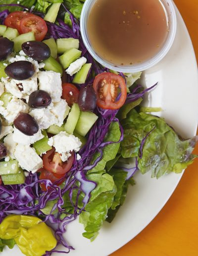 Greek salad with side of dressing